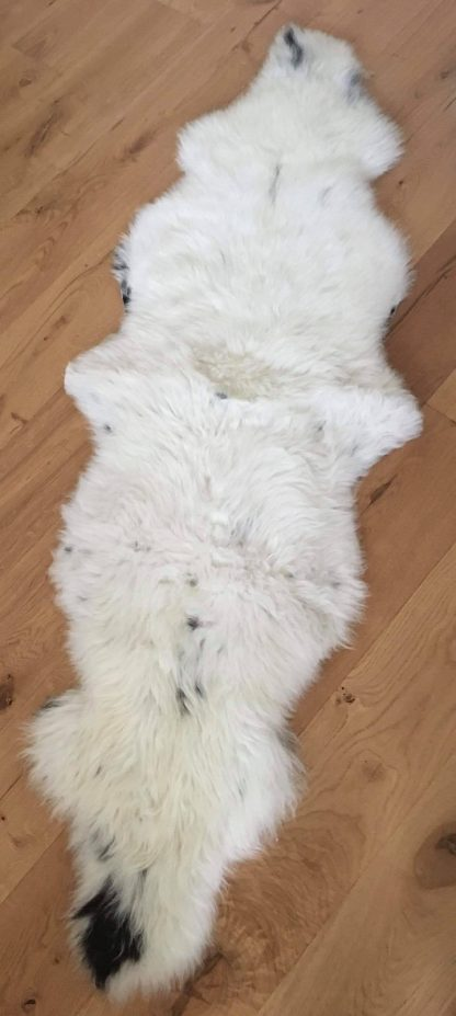 Double natural rare breed Sheepskin on wooden floor
