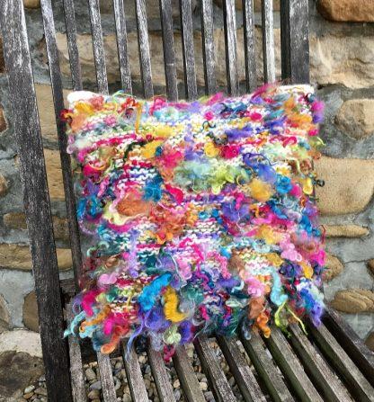 Wensleydale Dyed Fleece Cushion on chair