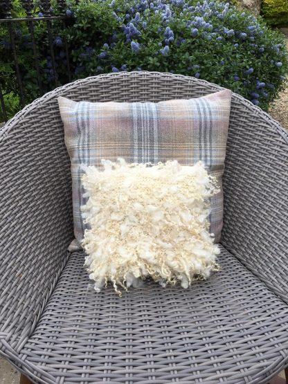 Wensleydale Undyed Natural fleece Cushion on garden chair