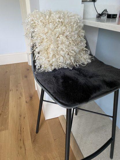 Wensleydale Fleece cushion on bar stool
