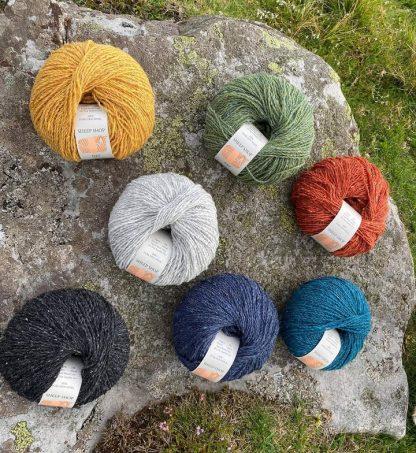Sheep Shop Nep donut balls lying on Yorkshire Dales rock